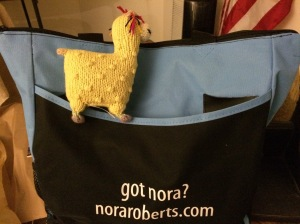 https://ttpbooks.com/ Nora's book bag holding all the books I bought and authors signed.  The stuffed animal is from the Free trade store at Harper's Ferry